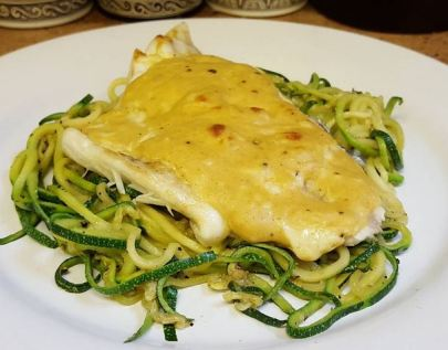 Bream and cheese sauce